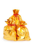 Golden sacks full of goods. Golden sacks full of something good stock images