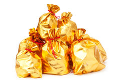 Golden sacks full of goods. Golden sacks full of something good royalty free stock photo