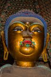Golden Sakyamuni. Close up of an 11m high statue of a golden Sakyamuni Buddha Stock Photo