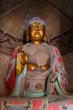Golden Sakyamuni. Close up of an 11m high statue of a golden Sakyamuni Buddha Royalty Free Stock Photos