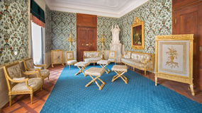 Golden saloon with the polychrome in lime wood carved furniture from 18. cent. in palace Saint Anton. Stock Image