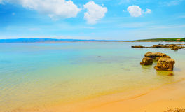 Golden sand in Alghero shoreline Royalty Free Stock Images