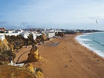 Golden sand beach in Albufeira Portugal with peaples sunbeds and stock photography