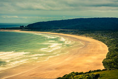 Golden sand beach in New Zealand. Beautiful golden sand beach in Catlins Forest Park, South Island, New Zealand royalty free stock photography