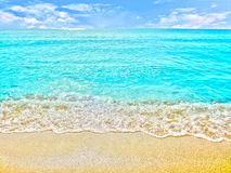 Golden sand with beach and tropical sea Royalty Free Stock Photos