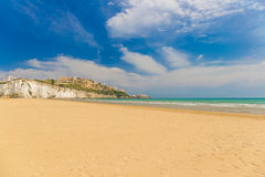 Golden sand beach of Vieste with Pizzomunno rock, Gargano peninsula, Apulia, South of Italy Royalty Free Stock Photos