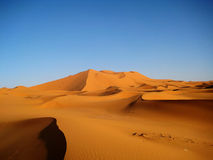 Golden Sand Dunes (Sahara). Erg Chebbi is a Saharan erg located in Merzouga (Morocco). Its dunes reach a height of up to 150 meters Royalty Free Stock Photo