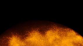 Golden sand or dust creating abstract formations In the form of the sun on black background. Art backgrounds.