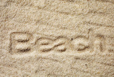 Golden sand with the indented word - Beach royalty free stock photos