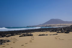 Golden sand with Mountain on Corralejo beach Canary islands Spai Stock Photography