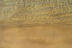 Golden sand and sea surface Stock Photography