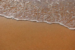 Golden sand and wave background a lot of space for text from above view Royalty Free Stock Photography