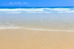 Golden sand and wave beach blue sky daylight landscape Royalty Free Stock Image