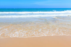 Golden sand and wave beach blue sky daylight landscape Royalty Free Stock Photo