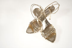 Golden sandals. A pair of golden sandals women's Rhinestone Royalty Free Stock Image