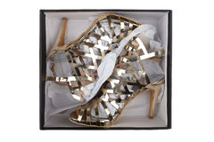 Golden sandals in a box Royalty Free Stock Photos