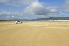 The golden sands of the deserted beach at Benone in County Londonderry on the North Coast of Ireland Stock Images