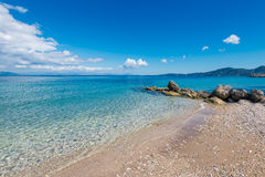 Golden sandy beach and Mediterranean sea near Agios Ioannis Peristeron. Royalty Free Stock Photos