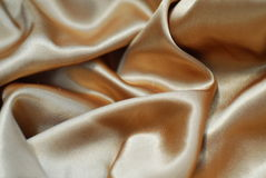 Golden satin. A beautiful luxury golden satin Royalty Free Stock Photo