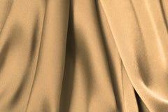 Golden Satin. Satin wave as background Stock Photography