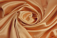 Golden satin background Royalty Free Stock Image