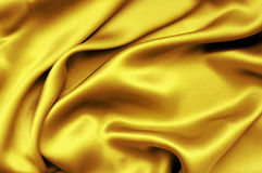 Golden satin background Stock Images