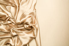 Golden satin background Stock Photography