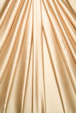 Golden satin curtain pattern Stock Photography