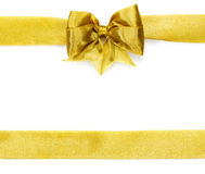 Golden satin gift bow. Ribbon Royalty Free Stock Photo