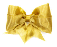 Golden satin gift bow. Ribbon Stock Images