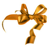 Golden satin gift bow. Ribbon Royalty Free Stock Images