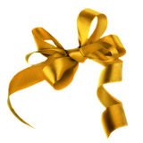 Golden satin gift bow. Ribbon. Isolated on white