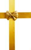 Golden satin ribbon Stock Images