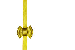Golden satin ribbon tied in a bow isolated on white Stock Photos