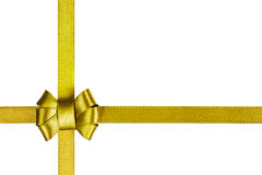 Golden satin ribbon tied in a bow isolated on white Royalty Free Stock Photo