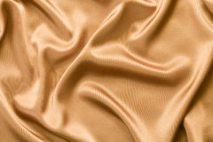 Golden satin or silk background Royalty Free Stock Photography