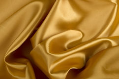 Golden satin or silk background Royalty Free Stock Photos