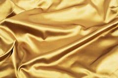 Golden satin or silk background, luxury elegant Royalty Free Stock Photo