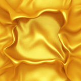 Golden satin silk cloth background with folds Stock Photos