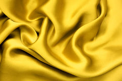 Golden satin textile background Stock Photography