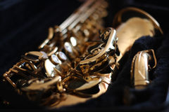 Golden saxophone. In black velvet case Royalty Free Stock Photos