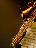 Golden saxophone on dark background. Golden saxophone on black background. Studio high-resolution image stock photography