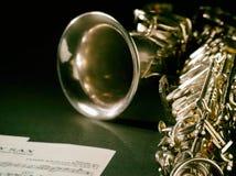 Golden saxophone on dark background. Golden saxophone on black background. Studio high-resolution image stock image