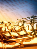 Golden saxophone on dark background. Golden saxophone  on blue background. Studio high-resolution image Stock Photo