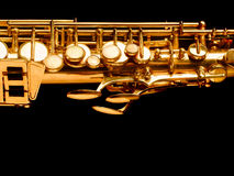 Golden saxophone on dark background. Golden saxophone isolated on black background. Studio high-resolution image royalty free stock photos