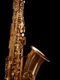 Golden saxophone on dark background. Golden saxophone isolated on black background. Studio high-resolution image Royalty Free Stock Photo