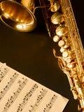 Golden saxophone on dark background. Golden saxophone  on dark background. Studio high-resolution image Stock Photo