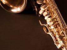 Golden saxophone on dark background. Golden saxophone  on dark background. Studio high-resolution image Royalty Free Stock Image