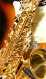 Golden saxophone Stock Images