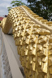 Golden scale of naga statue. At Thai temple Royalty Free Stock Photography
